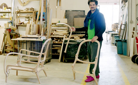 Jaime Hayon with 22 pieces of his Armchair 22