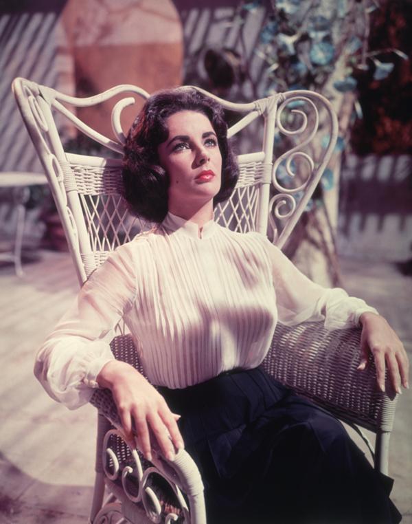 Liz Taylor on chair