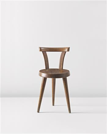 Three-legged chair by Charlotte Perriand