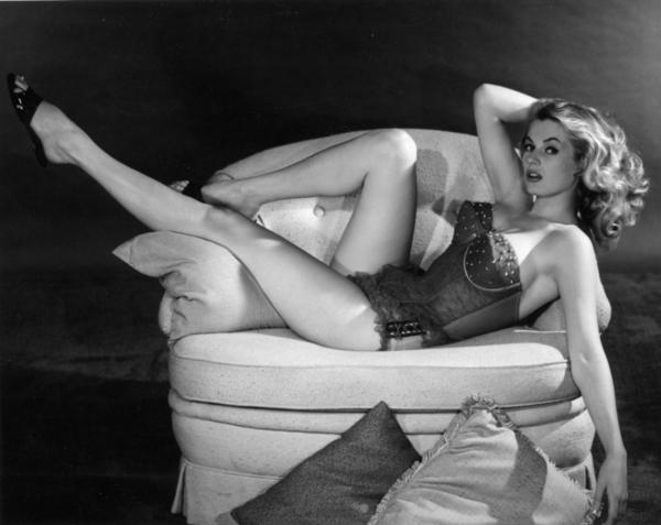 Anita-Ekberg-draped-on-a-sofa