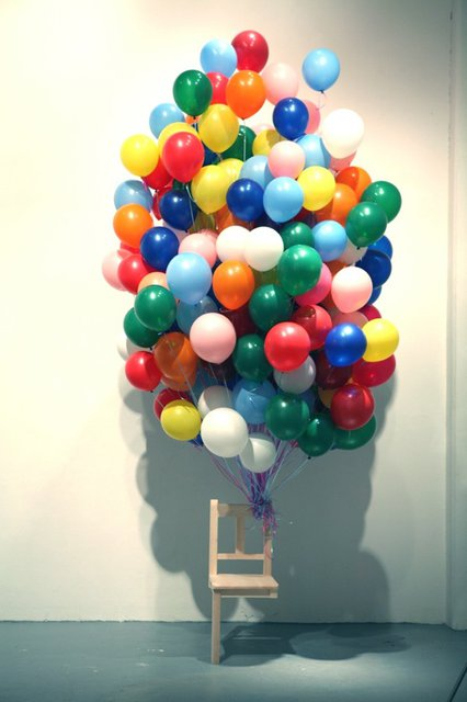 Leg Less Chair Held Up With Balloons