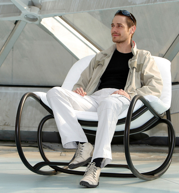 Wave-Rocking-Chair-by-Michal-Riabic-for-Ton-seated-on